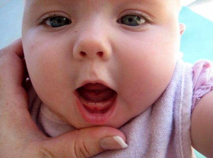 dấu hiệu trẻ mọc răng sữa truekidz canxi nano